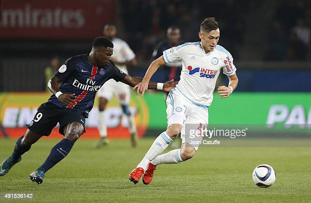 Lucas Ocampos of OM and Serge Aurier of PSG in action during the French Ligue 1 match between Paris SaintGermain FC and Olympique de Marseille at...