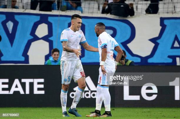 Lucas Ocampos of OM celebrates his goal with Dimitri Payet during the French Ligue 1 match between Olympique de Marseille and Toulouse FC at Stade...