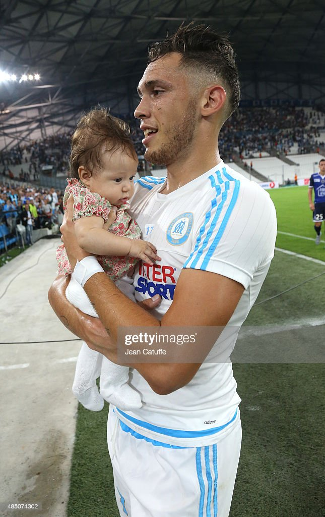Lucas Ocampos of OM holds his daughter Luisana Ocampos (4 months old) after the French Ligue 1 match between Olympique de Marseille (OM) and Troyes ESTAC at New Stade Velodrome on August 23, 2015 in Marseille, France.