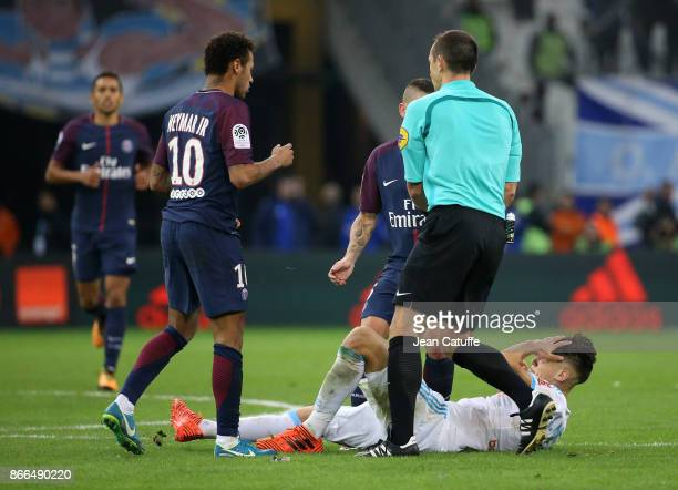 Lucas Ocampos of OM pretends being hit by Neymar Jr of PSG while referee Ruddy Buquet looks on during the French Ligue 1 match between Olympique de...