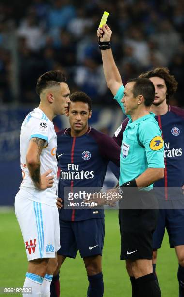Lucas Ocampos of OM then Neymar Jr of PSG receive a yellow card from referee Ruddy Buquet during the French Ligue 1 match between Olympique de...