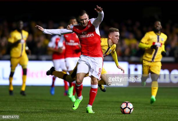 Lucas of Arsenal battles for the ball with Adam May of Sutton United during the Emirates FA Cup fifth round match between Sutton United and Arsenal...