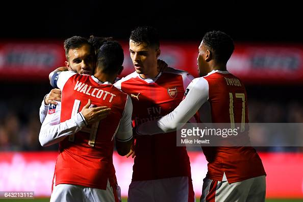 Lucas of Arsenal celebrates with teammates after scoring the opening goal during the Emirates FA Cup fifth round match between Sutton United and...