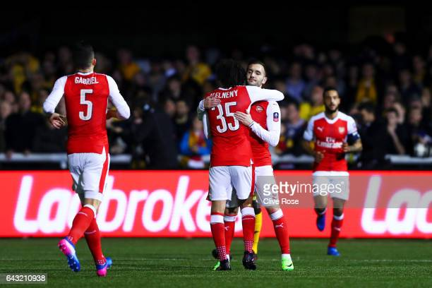 Lucas of Arsenal celebrates with teammates after scporing the opening goal during the Emirates FA Cup fifth round match between Sutton United and...