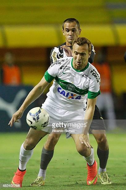 Lucas of Botafogo strugles for the ball with Ze Love of Coritiba during the match between Botafogo and Coritiba at Raulino de Oliveira Stadium on...
