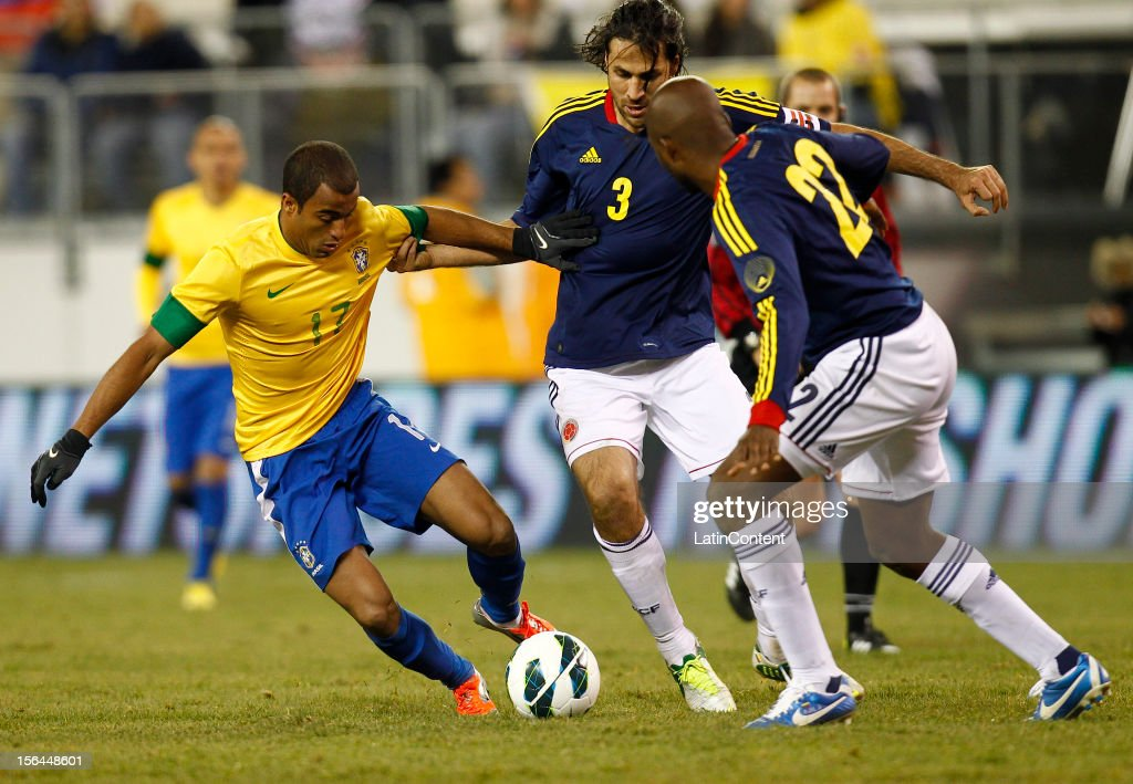 Lucas of Brazil tries to get around Mario Alberto Yepes of Colombia during a FIFA Friendly match between Colombia and Brazil at the MetLife Stadium on November 14, 2012 in New Jersey, US.