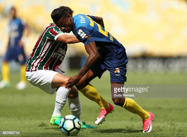 Lucas of Fluminense struggles for the ball with Bruno Henrique of Santos during a match between Fluminense and Santos as part of Brasileirao Series A...