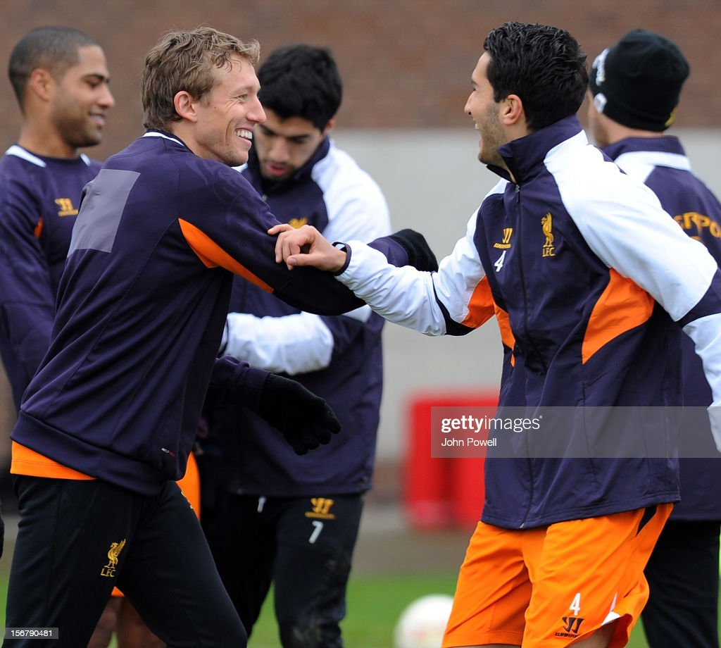 OUT. Lucas of Liverpool and Nuri Sahin of Liverpool at Melwood Training Ground on November 21, 2012 in Liverpool, England.