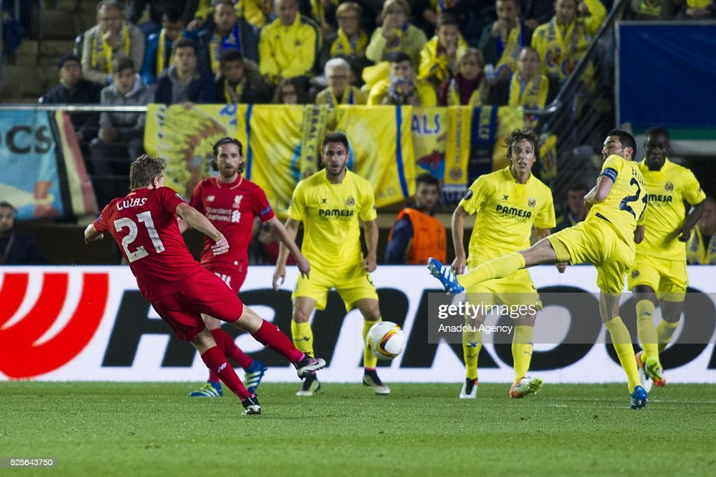 Lucas (L) of Liverpool in action during the UEFA Europa League Semi Final match between Villarreal and Liverpool at Estadio El Madrigal in Villareal, Spain on April 28, 2016.