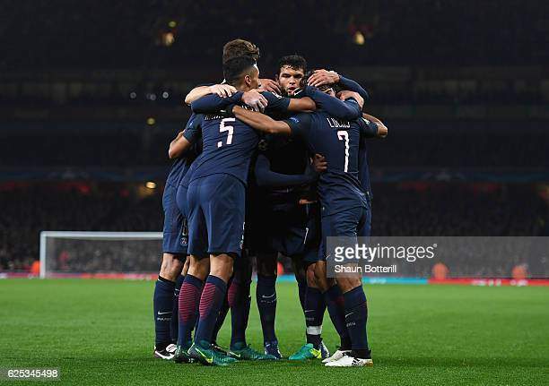 Lucas of PSG celebrates scoring his sides second goal with his PSG team mates during the UEFA Champions League Group A match between Arsenal FC and...