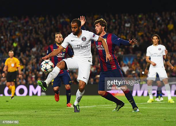 Lucas of PSG holds off Sergi Roberto of Barcelona during the UEFA Champions League Quarter Final second leg match between FC Barcelona and Paris...