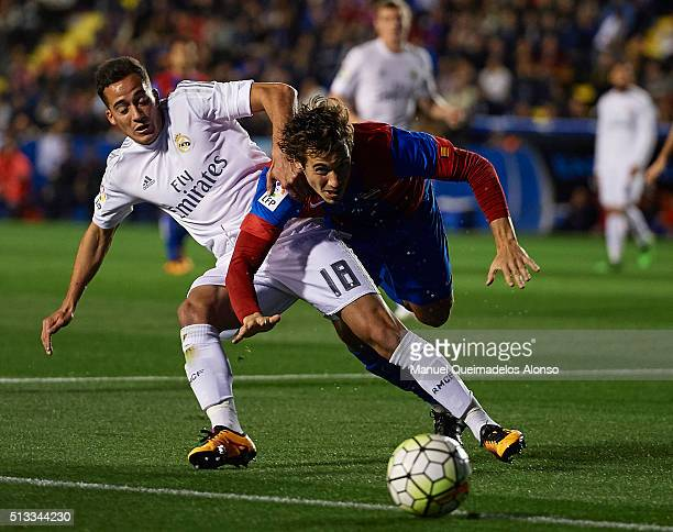 Lucas Orban of Levante competes for the ball with Lucas Vazquez of Real Madrid during the La Liga match between Levante UD and Real Madrid at Ciutat...