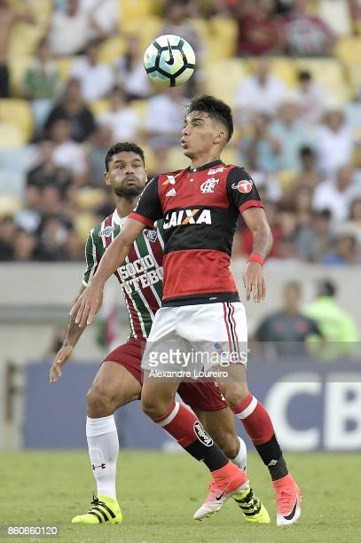 Lucas Paquet of Flamengo battles for the ball with Gum of Fluminense during the match between Flamengo and Fluminense as part of Brasileirao Series A...