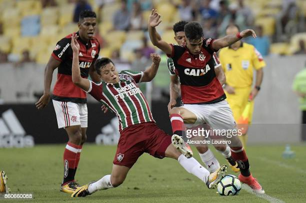 Lucas Paquet of Flamengo battles for the ball with Junior Sornoza of Fluminense during the match between Flamengo and Fluminense as part of...
