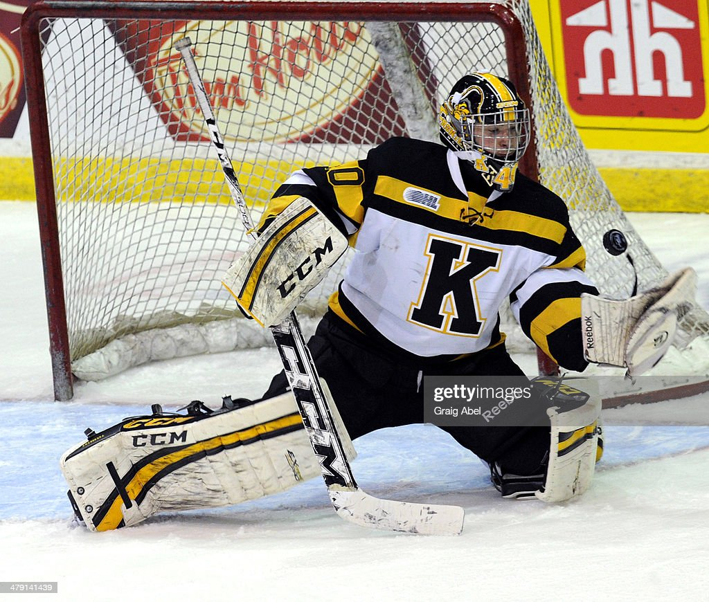 Lucas Peressini #40 of the Kingston Frontenacs stops a shot against the Mississauga Steelheads during game action on March 16, 2014 at the Hershey Centre in Mississauga, Ontario, Canada.