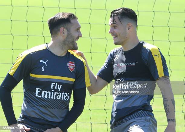 Lucas Perez and Granit Xhaka of Arsenal during a training session at London Colney on May 26 2017 in St Albans England