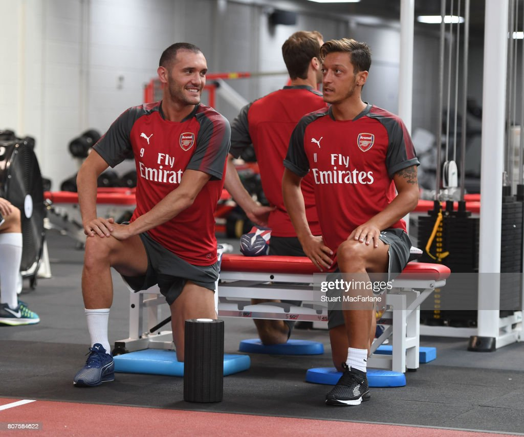 Lucas Perez and Mesut Ozil of Arsenal during a training session at London Colney on July 4, 2017 in St Albans, England.