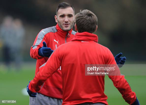 Lucas Perez and Nacho Monreal of Arsenal during a training session at London Colney on December 2 2016 in St Albans England