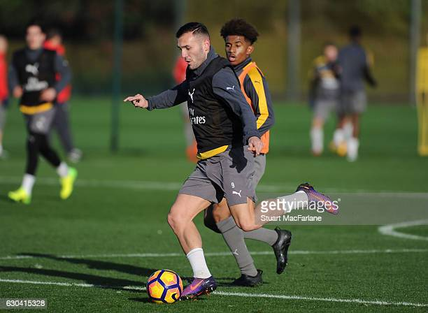 Lucas Perez and Reiss Nelson of Arsenal during a training session at London Colney on December 22 2016 in St Albans England