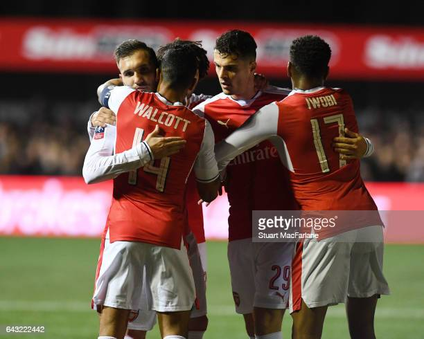 Lucas Perez celebrates scoring for Arsenal with Theo Walcott Gtranit Xhaka and Alex Iwobi during the Emirates FA Cup Fifth Round match between Sutton...