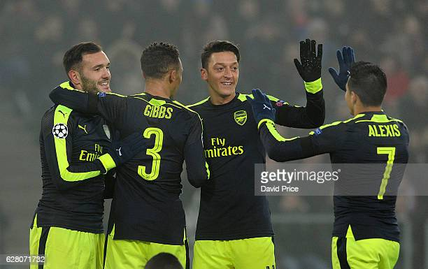 Lucas Perez celebrates scoring his and Arsenal's 2nd goal with Kieran Gibbs Mesut Ozil and Alexis Sanchez during the UEFA Champions League match...