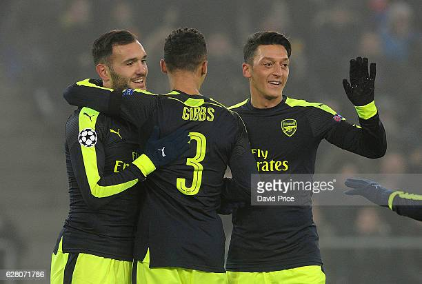 Lucas Perez celebrates scoring his and Arsenal's 2nd goal with Kieran Gibbs and Mesut Ozil during the UEFA Champions League match between FC Basel...
