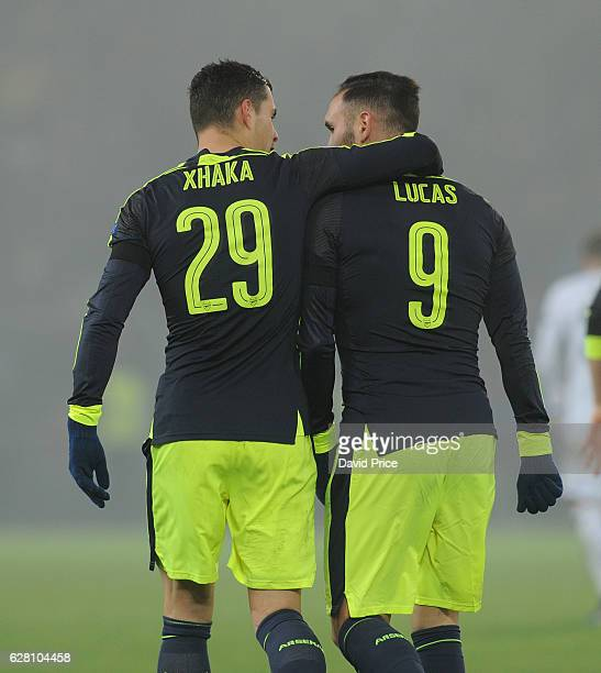 Lucas Perez celebrates scoring his and Arsenal's 3rd goal with Granit Xhaka during the UEFA Champions League match between FC Basel and Arsenal at St...