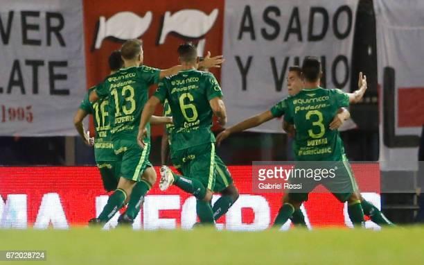 Lucas Perez Godoy of Sarmiento celebrates with teammates Francisco Dutari Guillermo Cosaro Rodrigo Depetris and Patricio Vidal after scoring the...