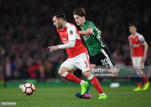 Lucas Perez of Arsenal breaks past Alex Woodyard of Lincoln during the Emirates FA Cup QuarterFinal between Arsenal and Lincoln City at Emirates...