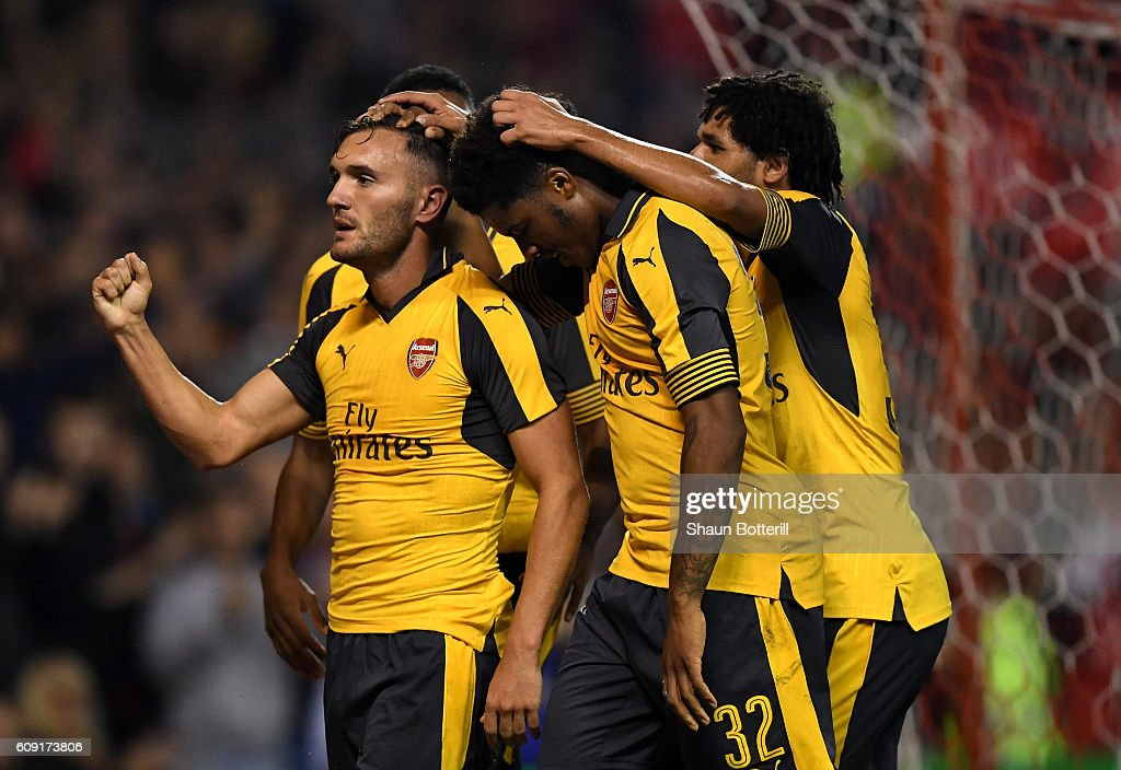 Lucas Perez (L) of Arsenal celebrates scoring his team's third goal during the EFL Cup Third Round match between Nottingham Forest and Arsenal at City Ground on September 20, 2016 in Nottingham, England.