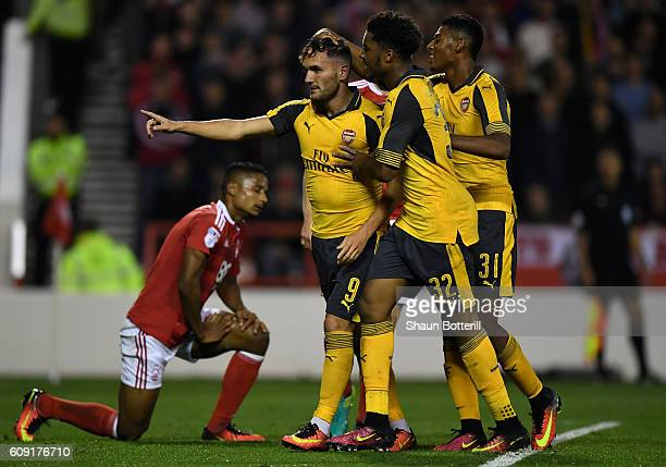 Lucas Perez of Arsenal celebrates scoring his team's third goal with Jeff ReineAdelaide and Chuba Akpom of Arsenal during the EFL Cup Third Round...