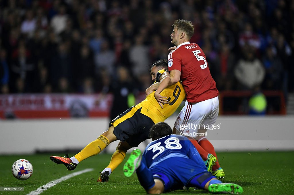 Lucas Perez of Arsenal scores his team's third goal during the EFL Cup Third Round match between Nottingham Forest and Arsenal at City Ground on September 20, 2016 in Nottingham, England.