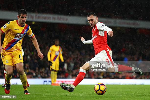 Lucas Perez of Arsenal takes a shot on goal during the Premier League match between Arsenal and Crystal Palace at the Emirates Stadium on January 1...