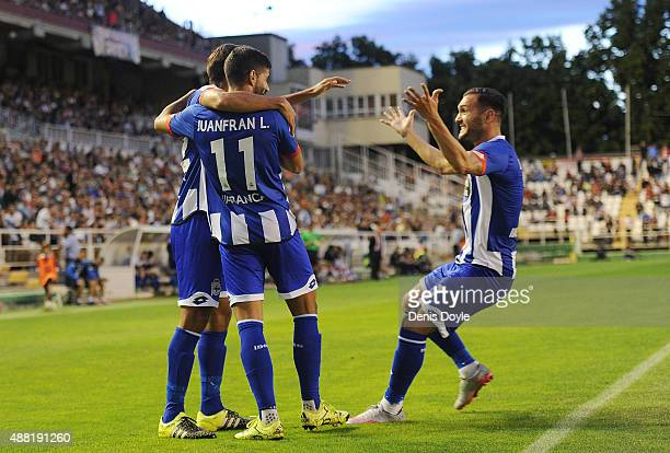 Lucas Perez of RC Deportivo la Coruna celebrates with Juanfran after Carlos Borges scored their opening goal during the La Liga match between Rayo...