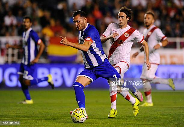 Lucas Perez of RC Deportivo la Coruna gets past Raul Baena of Rayo Vallecano during the La Liga match between Rayo Vallecano and RC Deportivo La...