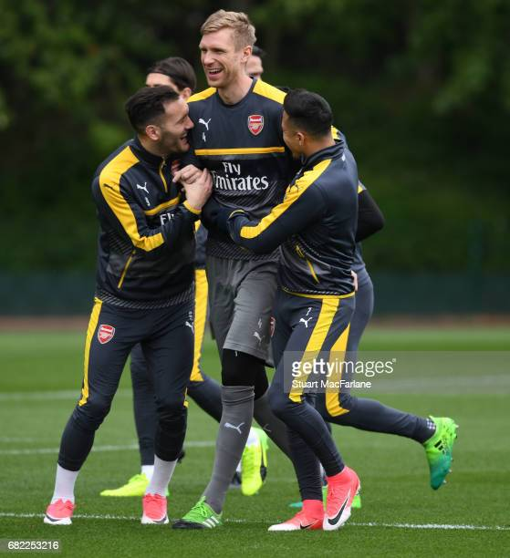 Lucas Perez Per Mertesacker and Alexis Sanchez of Arsenal during a training session at London Colney on May 12 2017 in St Albans England