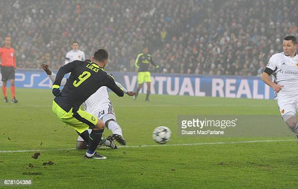 Lucas Perez scores the 2nd Arsenal goal during the UEFA Champions League match between FC Basel and Arsenal at St JakobPark on December 6 2016 in...