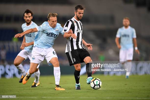 Lucas Pezzini Leiva and Miralem Pjanic during the Italian Supercup match between Juventus and SS Lazio at Stadio Olimpico on August 13 2017 in Rome...