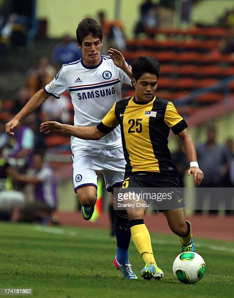 Lucas Piazon of Chelsea competes for the ball with Nazmi Faiz of Malaysia during the match between Chelsea and Malaysia XI on July 21 2013 at the...