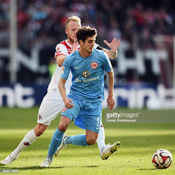 Lucas Piazon of Frankfurt is challenged by Kevin Voigt of Koeln during the Bundesliga match between 1 FC Koeln and Eintracht Frankfurt at...