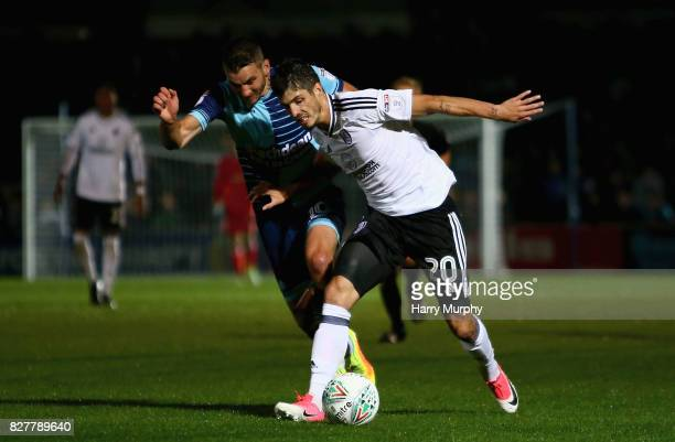 Lucas Piazon of Fulham and Matt Bloomfield of Wycombe Wanderers battle for possession during the Carabao Cup First Round match between Wycombe...