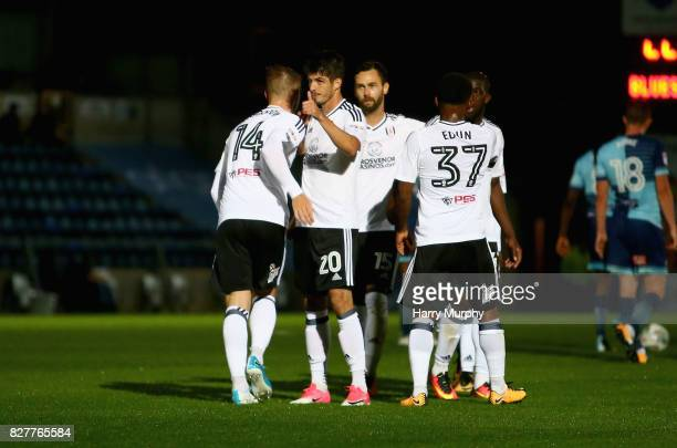 Lucas Piazon of Fulham celebrates scoring his teams first goal with teammates during the Carabao Cup First Round match between Wycombe Wanderers and...