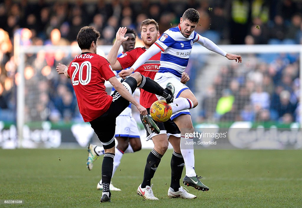 Lucas Piazon of Fulham FC (L) and Pawal Wszolek of Queens Park Rangers (R) battle for possession during the Sky Bet Championship match between Queens Park Rangers and Fulham at Loftus Road on January 21, 2017 in London, England.