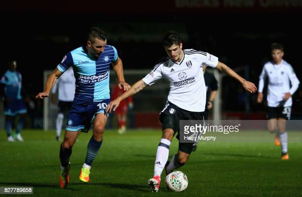Lucas Piazon of Fulham is closed down by Matt Bloomfield of Wycombe Wanderers during the Carabao Cup First Round match between Wycombe Wanderers and...