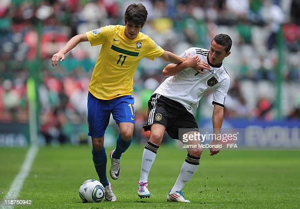 Lucas Piazon of Germany battles with Samed Yesil of Germany during the FIFA U17 World Cup Mexico 2011 3rd Place Playoff match between Brazil and...