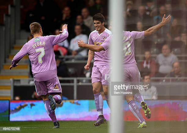 Lucas Piazon of Reading celebrates with team mates after scoring his team's first goal of the game during the Sky Bet Championship match between...