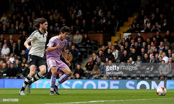 Lucas Piazon of Reading scores his team's first goal of the game under pressure from Richard Stearman of Fulham during the Sky Bet Championship match...
