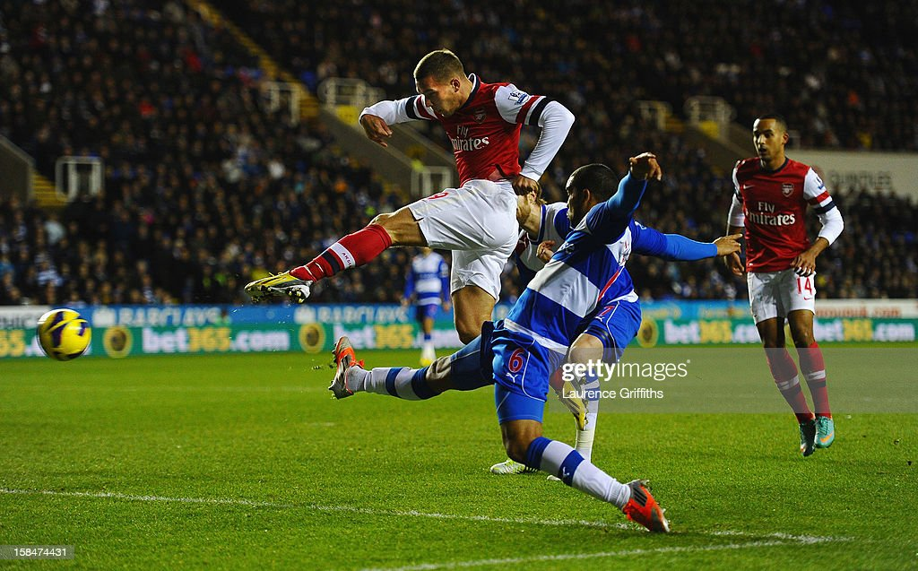 Lucas Podolski of Arsenal fires the ball home to score the opening goal during the Barclays Premier League match between Reading and Arsenal at Madejski Stadium on December 17, 2012 in Reading, England.