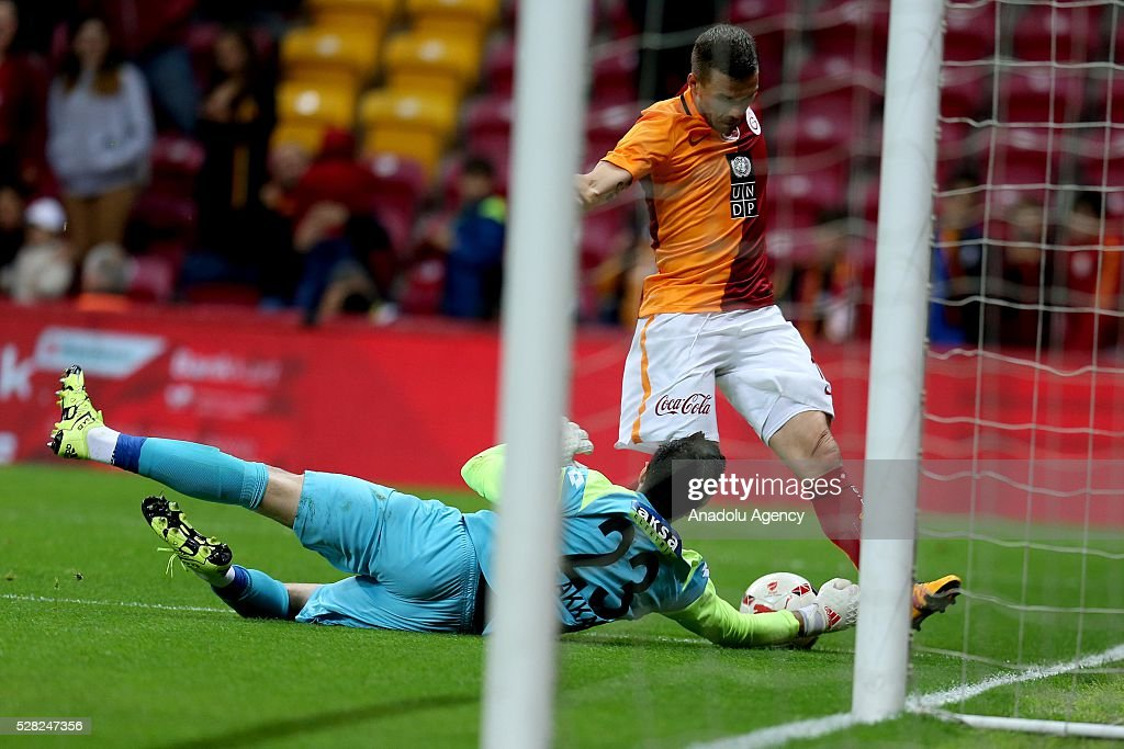 Lucas Podolski (rear) of Galatasaray in an action during the during Ziraat Turkish Cup Semi Final second leg football match between Galatasaray and Caykur Rize Spor at Turk Telekom Arena in Istanbul, Turkey on May 4, 2016.