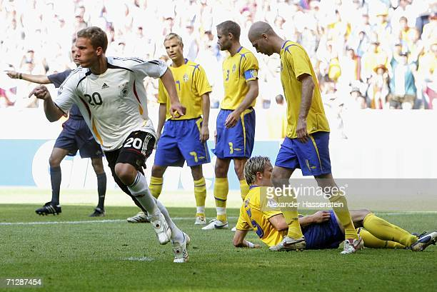 Lucas Podolski of Germany celebrates after scoring his team's second goal during the FIFA World Cup Germany 2006 Round of 16 match between Germany...